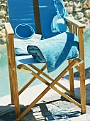 Swimming things draped on chair