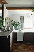 A bathroom with wooden panelling