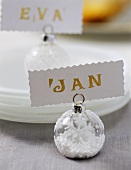 Christmas bauble used as place card holder