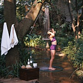 Girl showering in garden