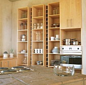 Kitchen with wooden shelves, cooker and island counter