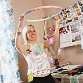 Woman hanging up children's mobile