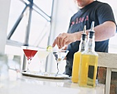 A man mixing Martini cocktails