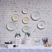 Christmas decoration on a table and hand-painted plates on a wall