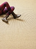 Person lying on sisal rug