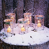 Candle lanterns in snow