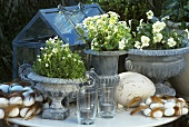 Easter decorations in garden: romantic flowerpots, eggs, feathers