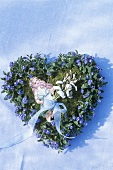 Forget-me-nots forming a heart, cut-out girl in the centre