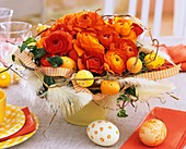 Orange Easter arrangement of ranunculus