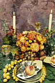 Summery table with fruit and roses out of doors