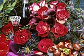 Vase of red and white roses, liqueur and sweet chestnuts