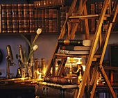 Shelves of antique books and step ladder
