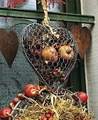 Door wreath & wire netting heart filled with fruit & dried plants