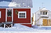Nordische Holzhäuser im Winter