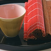 Raffia mats and beaker on tray