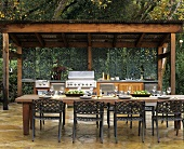 Outdoor kitchen and laid table