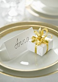 Decorative place setting with a name card at a wedding table