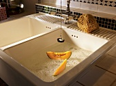 Melon slices in a sink with water