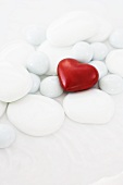 White stones with a red heart