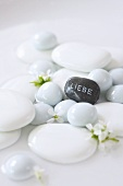White stones and a grey stone with the word 'Liebe' (Love) written on it