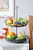 A wire etagere filed with fruit