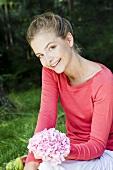 Woman holding hydrangea flower in garden