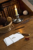 Writing desk with writing paper and candle