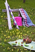 Picnic cloth, various textiles and rolls of oilcloth