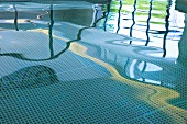 Reflective water surface in indoor swimming pool
