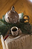 Cup of tea and teapot with Christmas decorations