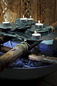 Rocks and tealights in spa (decoration)