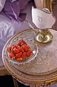 Fresh strawberries on occasional table in Château de la Verrerie (France)