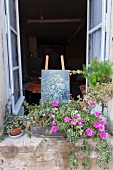 Open window in a romantic house with easel