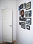 Photos on wall and toilet door