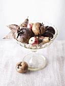 Wooden fruit in glass