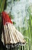 Incense sticks (lit)