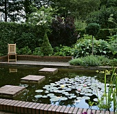 Ornamental garden with pond and aquatic plants