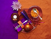 Purple and orange Christmas place-setting with jelly beans