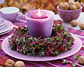 Windlight with wreath of heather, hydrangeas, beauty berries