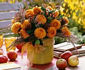 Vase of dahlias, heather and hypericum berries