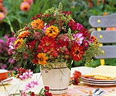 Colourful arrangement of zinnias, cosmos, sweet williams