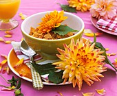 Breakfast place-setting with cornflakes and dahlias