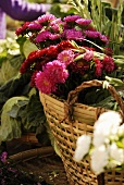 Basket of flowers and vegetables on a market stall