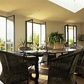 Dining table with rattan armchairs
