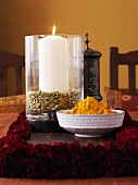 Bowl of Indian spice mixture and a candle