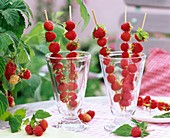 Raspberry skewers in glasses