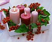Candles with redcurrants (table decoration)