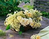 Basket of elderflowers and roses