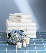 Bath towels, hydrangea flower and candles