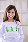 Girl wearing t-shirt with Christmas tree motifs